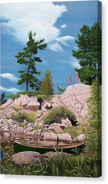 Canoe Among The Rocks Canvas Print