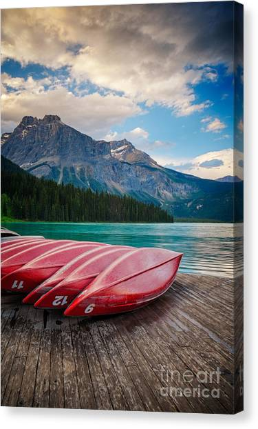 Canvas Print featuring the photograph Canoes At Emerald Lake In Yoho National Park by Bryan Mullennix