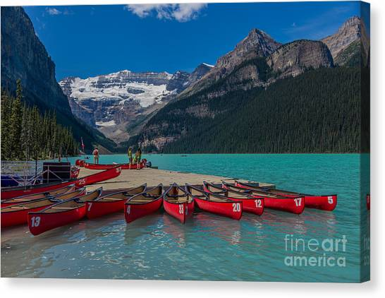 Canoes On Lake Louise Canvas Print