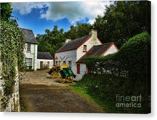 Cartwheel Cottages Canvas Print by Kim Shatwell-Irishphotographer