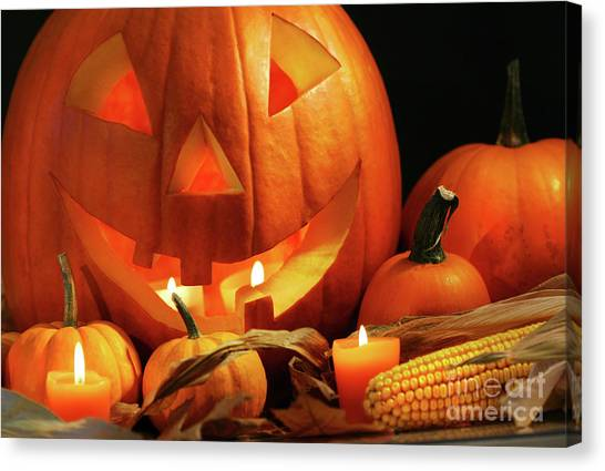 Carved Pumpkin With Candles Canvas Print