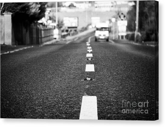 Brexit Canvas Print - catseyes in the middle of the road near the irish border between Northern Ireland and Republic of Ir by Joe Fox