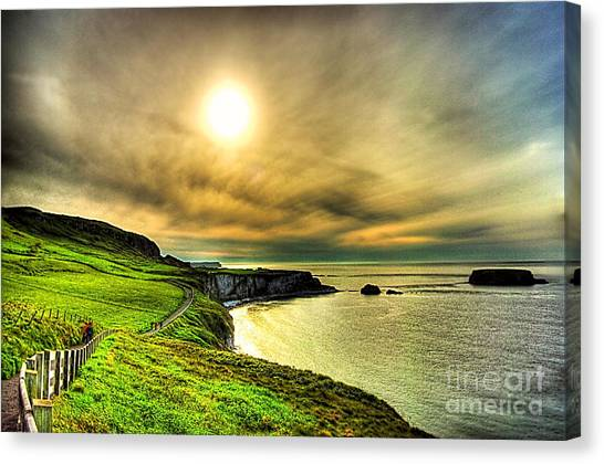 Causeway Sunset Walk Canvas Print by Kim Shatwell-Irishphotographer