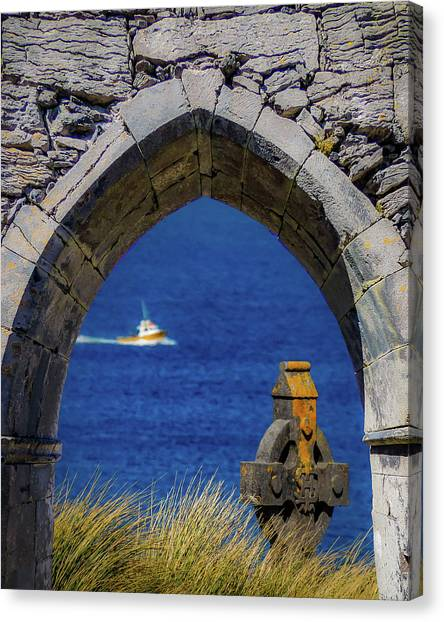 Canvas Print featuring the photograph Celtic Cross And Fishing Vessel From Isle Of Inisheer by James Truett