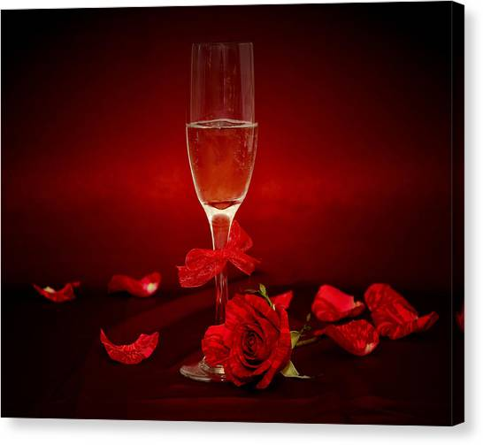 Champagne Glass With Red Roses And Petals Canvas Print