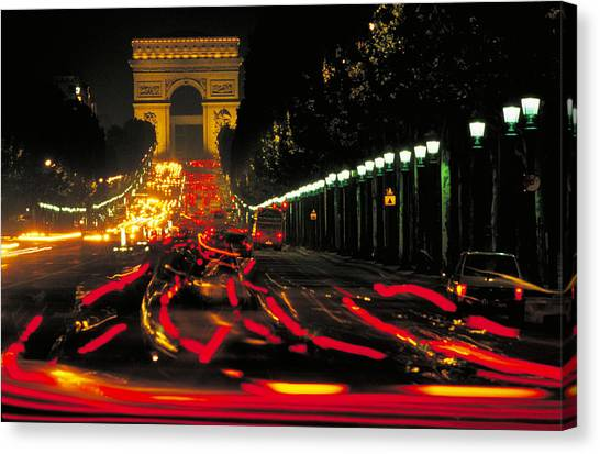 Champs Elysee In Paris Canvas Print by Carl Purcell