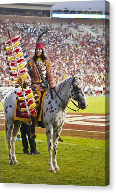 Florida State Fsu Canvas Print - Chief Osceola And Renegade On Bobby Bowden Field by Frank Feliciano