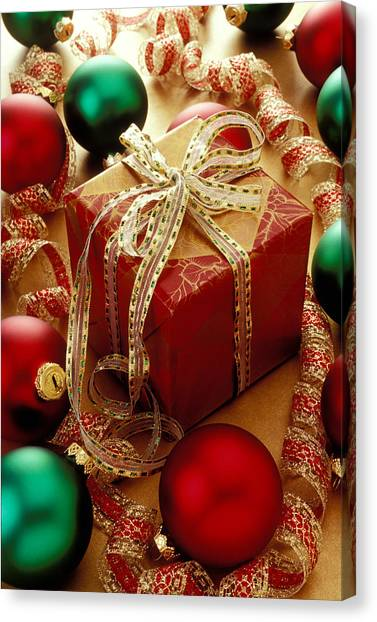 Bow Canvas Print - Christmas Present And Ornaments by Garry Gay