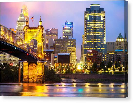 Canvas Print featuring the photograph Cincinnati Skyline And The John Roebling Suspension Bridge by Gregory Ballos