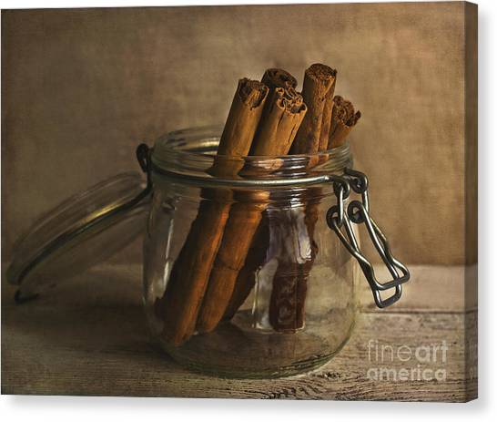 Cinnamon Sticks In A Glass Jar Canvas Print