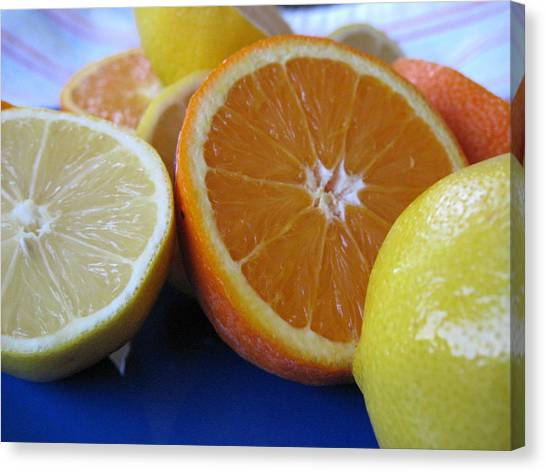 Citrus On Blue Plate Canvas Print