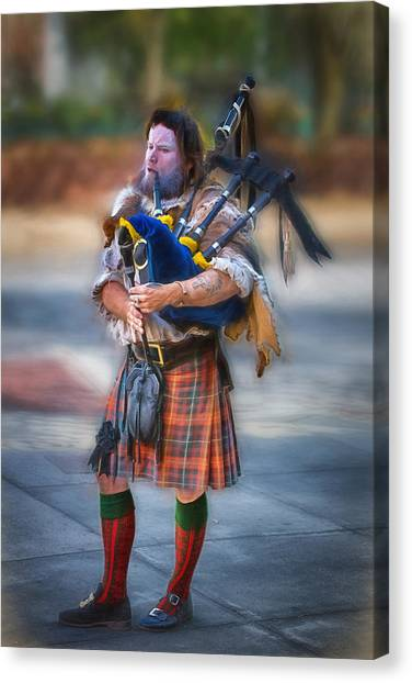 Clan Macintosh Piper Canvas Print by John Haldane