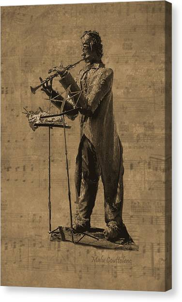 Clarinet Player Canvas Print by Malu Couttolenc