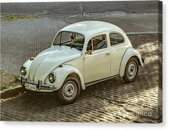 Classic Beetle Car Parked On Street Canvas Print by Daniel Ferreira-Leites