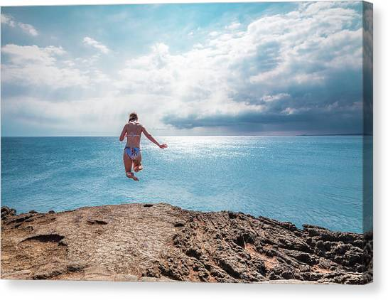 Canvas Print featuring the photograph Cliff Jumping by Break The Silhouette