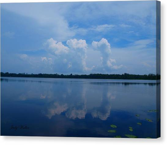 Cloud Reflections Canvas Print by Judy  Waller