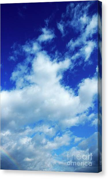 Clouds In A Beautiful Blue Sky Canvas Print by Sami Sarkis