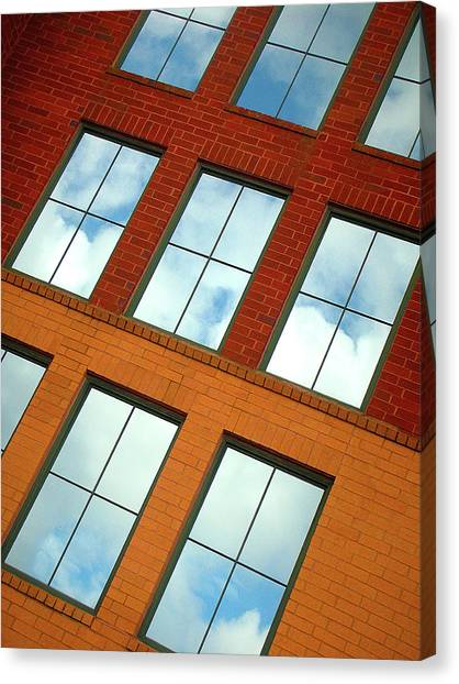 Clouds In The Windows Canvas Print