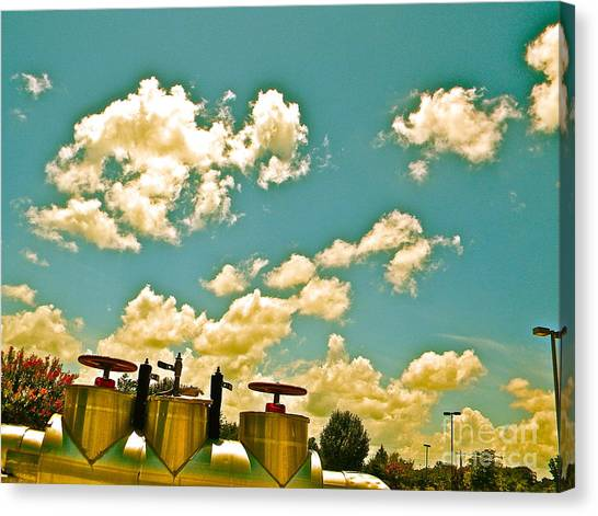Clouds Over Oil Field Equipent Canvas Print by Chuck Taylor