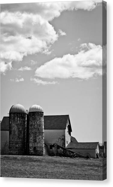Timeworn Canvas Print - Clouds Over Silos by Colleen Kammerer