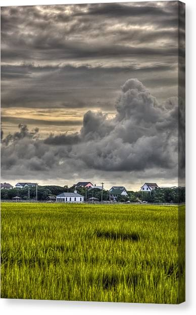 Clouds Over The Chapel Canvas Print by Ginny Horton
