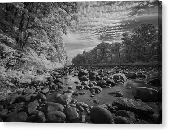 Clouds Over The River Rocks Canvas Print