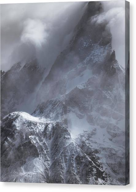 Clouds Rolling Over The Tops Of The Mountain In Torres Del Paine, Chile Canvas Print