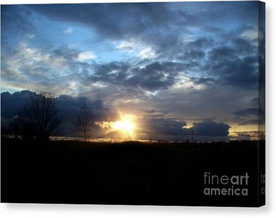 Cloudy Sunset Canvas Print by Emily Kelley