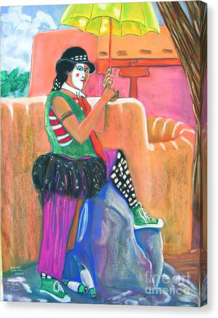 clown on Taos plaza Canvas Print by George Chacon