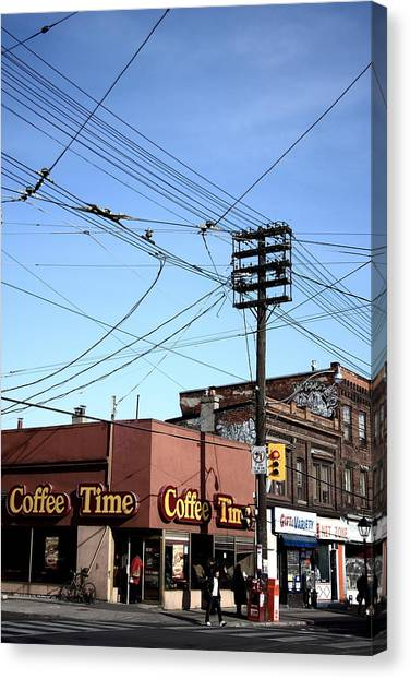 Coffee On The Corner Canvas Print by Kreddible Trout