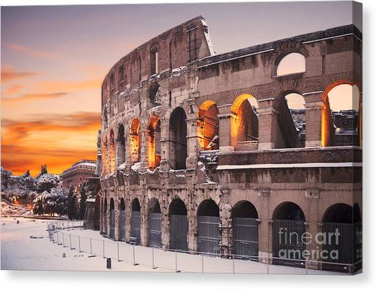 The Colosseum Canvas Print - Colosseum Covered In Snow At Sunset by Stefano Senise