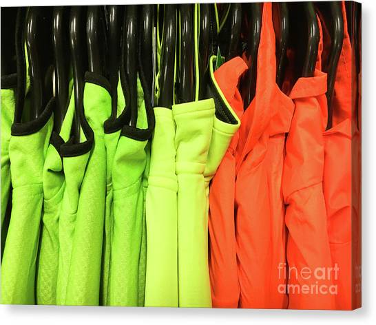 Protective Clothing Canvas Print - Colourful Sports Tops by Tom Gowanlock