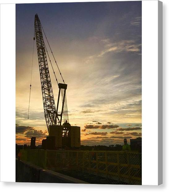 Industrial Canvas Print - Construction Crane At Sunrise by Juan Silva