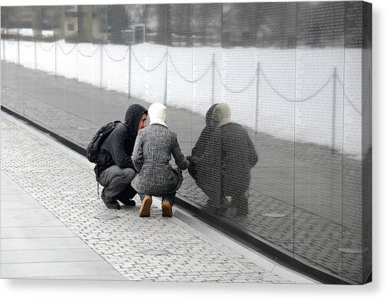Couple At Vietnam Wall Canvas Print