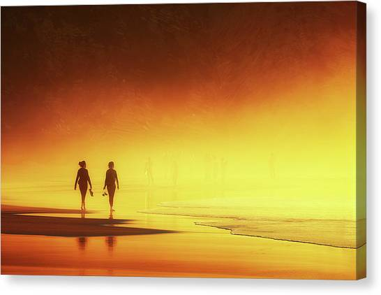 Couple Of Women Walking On Beach Canvas Print