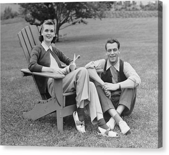 Couple Sitting Outdoors Canvas Print by George Marks