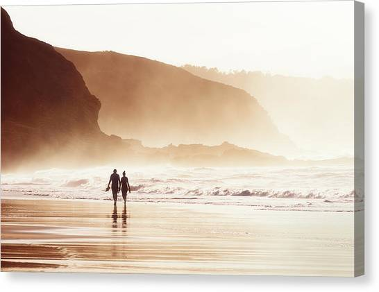 Couple Walking On Beach With Fog Canvas Print