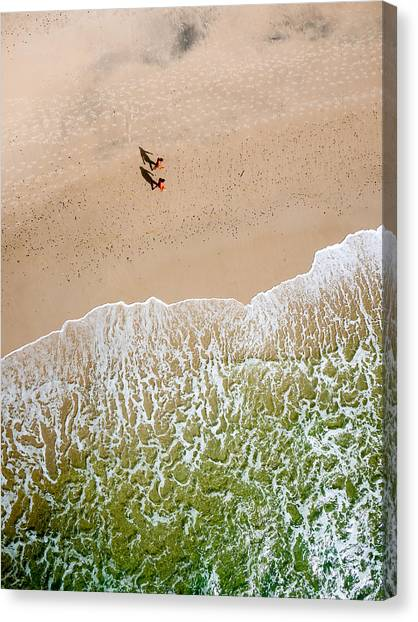 Couple Walking On Tallow Beach Canvas Print