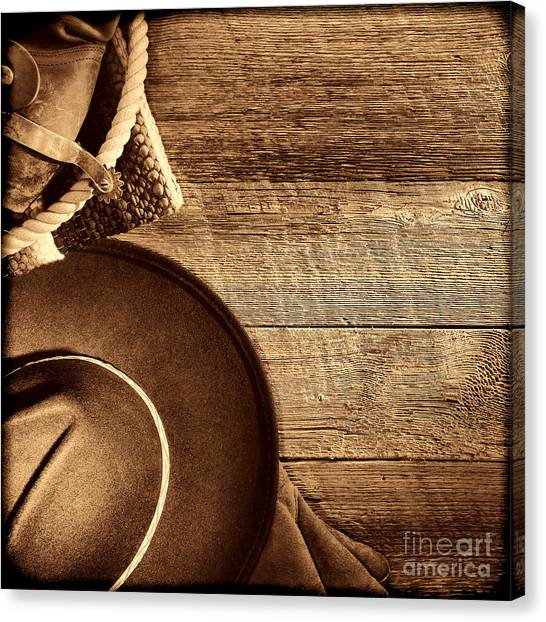 Cowboy Hat And Gear On Wood Canvas Print
