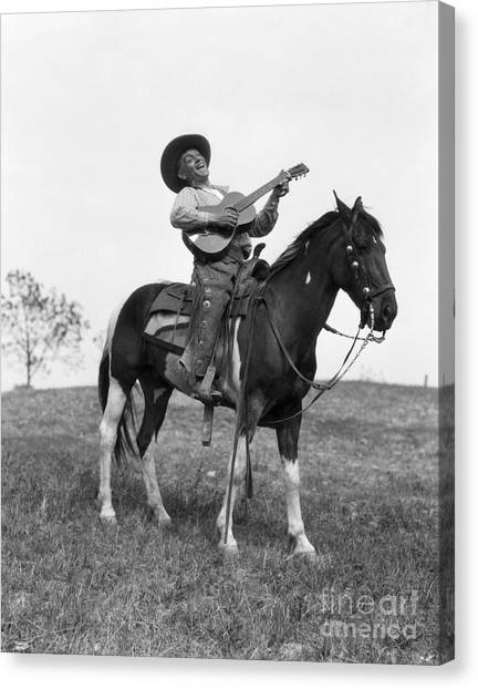 Funny Horses Canvas Print - Cowboy On Horse Singing And Playing by H. Armstrong Roberts/ClassicStock