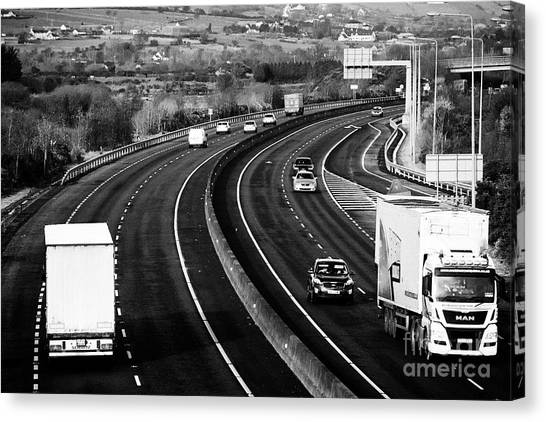 Brexit Canvas Print - cross border freight and vehicle traffic on the N1/M1 motorway crossing the irish border between Nor by Joe Fox