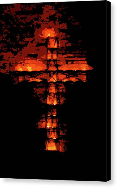 Cross On Fire Canvas Print by Andrea Mazzocchetti
