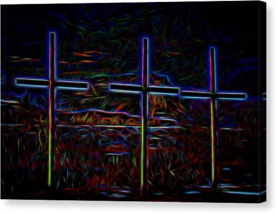 Crosses Under The Bluff Canvas Print by Tim Abshire