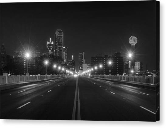 Canvas Print featuring the photograph Crossing The Bridge To Downtown Dallas At Night In Black And White by Todd Aaron