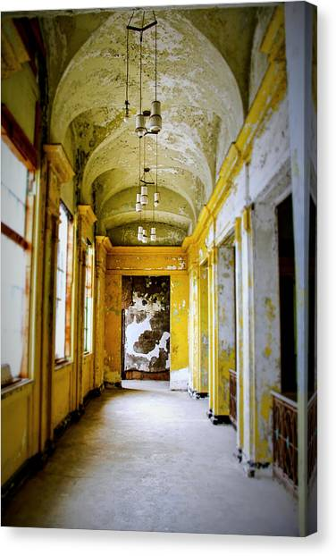 Crumbling Cathedral Corridor Canvas Print by Keith Rousseau
