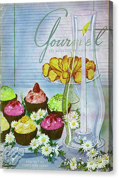 Cupcakes And Gaufrettes Beside A Candle Canvas Print