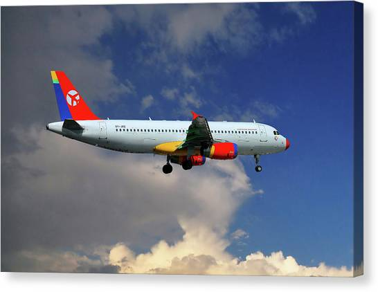 Airlines Canvas Print - Danish Air Transport Airbus A320-233 by Smart Aviation