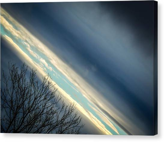 Dark Clouds Parting Canvas Print