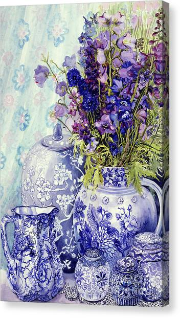 In Bloom Canvas Print - Delphiniums With Antique Blue Pots by Joan Thewsey