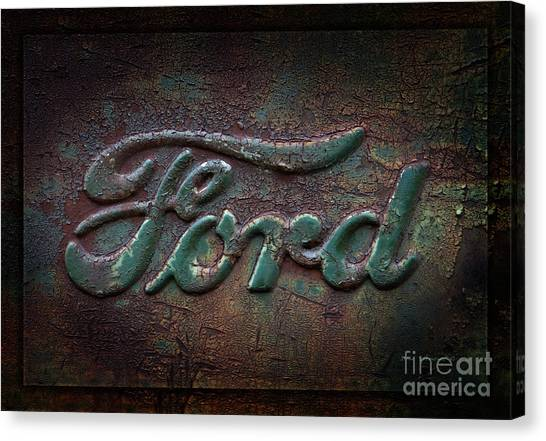 Ford Truck Canvas Print - Detail Old Rusty Ford Pickup Truck Emblem by John Stephens